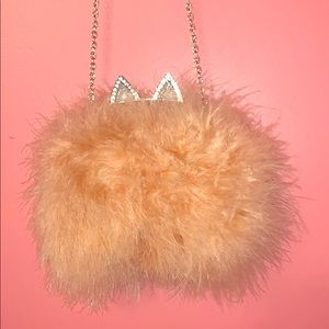 BCEGMAXAZRIA fox fur clutch with chain.